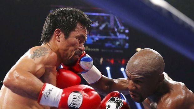 Mayweather pernah mengalahkan Pacquiao. (