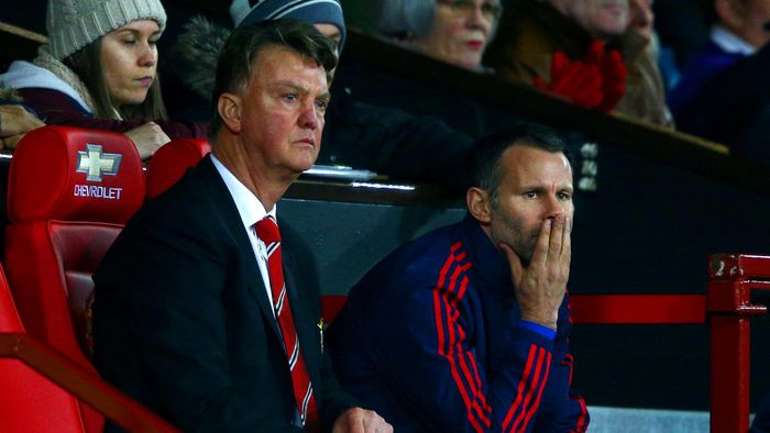 MANCHESTER, ENGLAND - DECEMBER 28:  Louis van Gaal, manager of Manchester United looks on from the bench next to his assistant Ryan Giggs during the Barclays Premier League match between Manchester United and Chelsea at Old Trafford on December 28, 2015 in Manchester, England.  (Photo by Clive Mason/Getty Images)