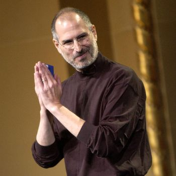 SAN JOSE, CA - OCTOBER 26: Steve Jobs of Apple Computer celebrates the release of a new Apple iPod family of products at the California Theatre on October 26, 2004 in San Jose California. (Photo by Tim Mosenfelder/Getty Images)