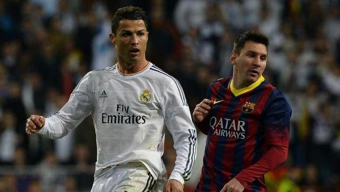 Rivalitas Cristiano Ronaldo dan Lionel Messi di Liga Spanyol berakhir di musim panas ini (Gerard Julien / AFP)