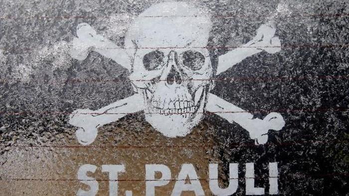 Logo Tengkorak kebanggaan St Pauli (Foto: MALTE CHRISTIANS/DPA/AFP)