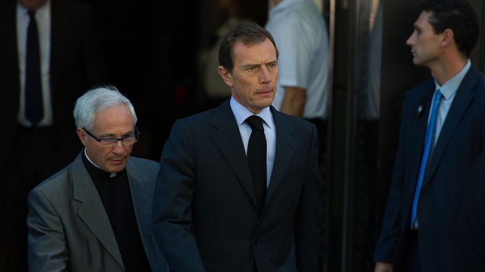 MADRID, SPAIN - JULY 08: Former Real Madrid player Emilio Butragueno leaves the Santiago Bernabeu stadium after the funeral wake for former Real Madrid great Alfredo Di Stefano on July 9, 2014 in Madrid, Spain. Di Stefano, who won 5 sucessive European Cups for Real died July 7 aged 88 in Madrid after earlier suffering a heart attack. (Photo by Denis Doyle/Getty Images)