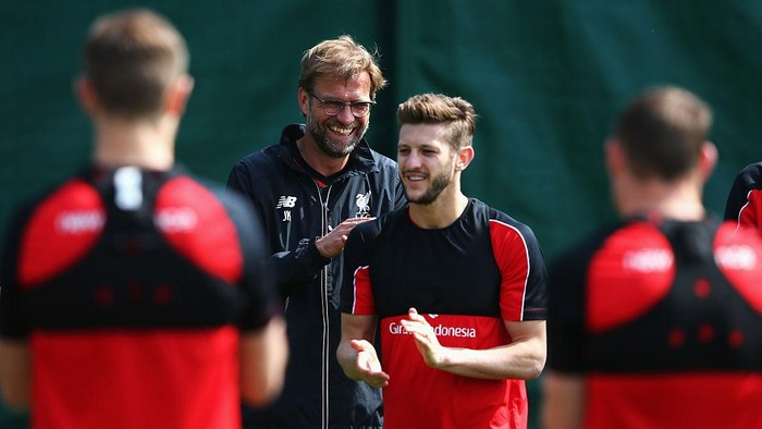 LIVERPOOL, ENGLAND - MAY 13:  Jurgen Klopp, manager of Liverpool laughs with Adam Lallana during a training session at the Liverpool UEFA Europa League Cup Final Media Day at Melwood Training Ground on May 13, 2016 in Liverpool, England.  (Photo by Alex Livesey/Getty Images)