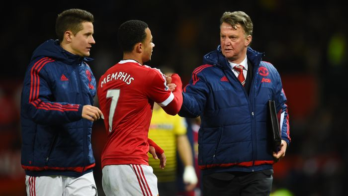 MANCHESTER, ENGLAND - MARCH 02: Louis van Gaal Manager of Manchester United shakes hands with Memphis Depay after the Barclays Premier League match between Manchester United and Watford at Old Trafford on March 2, 2016 in Manchester, England.  (Photo by Shaun Botterill/Getty Images)