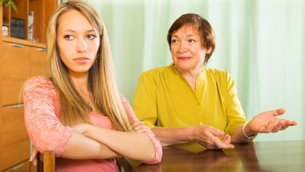 Mature mother and  adult daughter  after quarrel  in home  interior