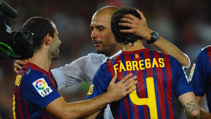 BARCELONA, SPAIN - AUGUST 17: Josep Guardiola  of Barcelona congratulates Cesc Fabregas and Javier Mascherano after victory in the Super Cup second leg match between Barcelona and Real Madrid at Nou Camp on August 17, 2011 in Barcelona, Spain.  (Photo by Laurence Griffiths/Getty Images)