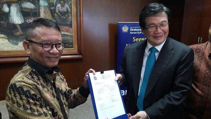 Prajogo Pangestu ketika Tax Amnesty (kanan)/Foto: Eduardo Simorangkir