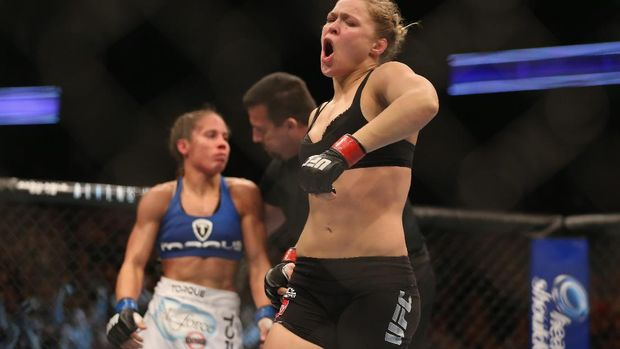 ANAHEIM, CA - FEBRUARY 23: Ronda Rousey celebrates her UFC Bantamweight Title over Liz Carmouche at Honda Center on February 23, 2013 in Anaheim, California.   Jeff Gross/Getty Images/AFP