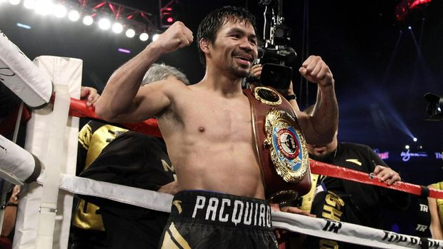 Boxer Manny Pacquiao of the Philippines celebrates after beating Jessie Vargas with a unanimous decision to win the WBO welterweight championship at the Thomas & Mack Center in Las Vegas, Nevada on November 5, 2016. / AFP PHOTO / John GURZINSKI