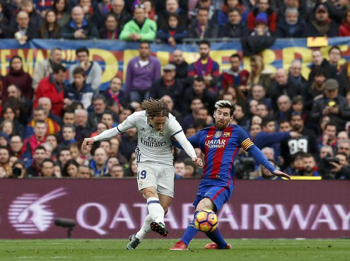Luka Modric menegaskan tidak akan bermain dengan Lionel Messi. (Foto: REUTERS/Albert Gea)