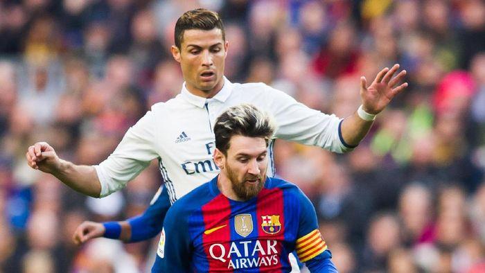 Ronaldo dan Lionel Messi berpeluang bertemu di final Liga Champions musim ini (Alex Caparros/Getty Images)