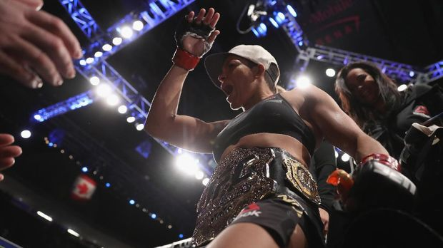 LAS VEGAS, NV - DECEMBER 30: Amanda Nunes of Brazil exits the Octagon after her victory over Ronda Rousey in their UFC women's bantamweight championship bout during the UFC 207 event on December 30, 2016 in Las Vegas, Nevada.   Christian Petersen/Getty Images/AFP