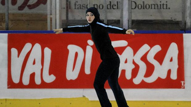 Emirati junior figure skater Zahra Lari warms up before the figure skating European Cup on April 12, 2012 in Canazei, northern Italy. 17-year-old Lari becomes the first Emirati figure skater to compete in an international competition with skaters from 50 countries taking part in the European Cup from April 9 to 13. AFP PHOTO/ANDREA SOLERO / AFP PHOTO / Andrea Solero