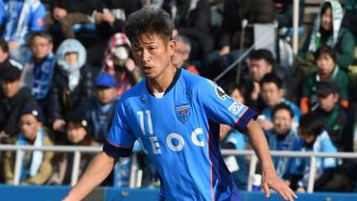 (FILES) This file picture taken on February 26, 2017 shows former Japans national team striker Kazuyoshi Miura of the J-League second-tier club Yokohama FC keeping the ball during the opening match of 2017 season against Matsumoto Yamaga in Yokohama, suburb of Tokyo.    Twinkle-toed Japanese footballer Kazuyoshi Miura has racked up another astonishing landmark by eclipsing former England great Stanley Matthews in the record books with his second professional appearance since turning 50. Miura, played in 1-1 draw match on March 5, 2017 against V-Varen Nagasaki at 50 years and seven days -- two days older than Matthews was when he turned out for Stoke City against Fulham in 1965. / AFP PHOTO / TORU YAMANAKA