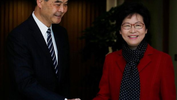Chief Executive Carrie Lam (R) meets current leader Leung Chun-ying in Hong Kong, China March 27, 2017