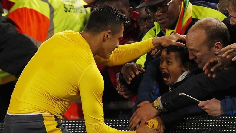 Ekspresi Alexis Sanchez Ini Akan Bikin Fans Arsenal Senang