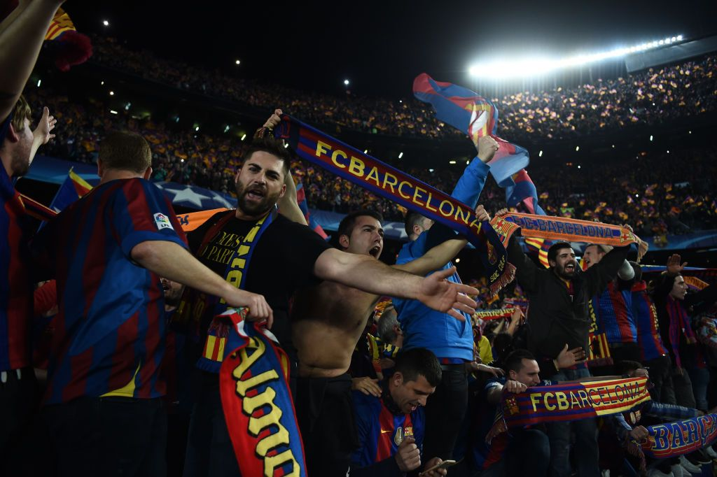 BARCELONA, SPAIN - MARCH 08:  Barcelona fans celebrate victory after the UEFA Champions League Round of 16 second leg match between FC Barcelona and Paris Saint-Germain at Camp Nou on March 8, 2017 in Barcelona, Spain.  (Photo by Laurence Griffiths/Getty Images)