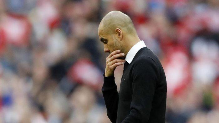 Josep Guardiola dituntut membawa Manchester City berprestasi di musim depan. Foto: Action Images via Reuters / Carl Recine