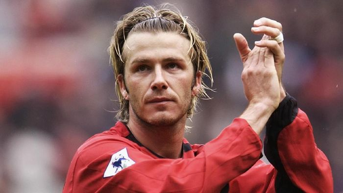 MANCHESTER - MAY 3:  David Beckham of Manchester United applauds the fans after the FA Barclaycard Premiership match between Manchester United and Charlton Athletic held on May 3, 2003 at Old Trafford, in Manchester, England. Manchester United won the match 4-1. (Photo by Shaun Botterill/Getty Images)