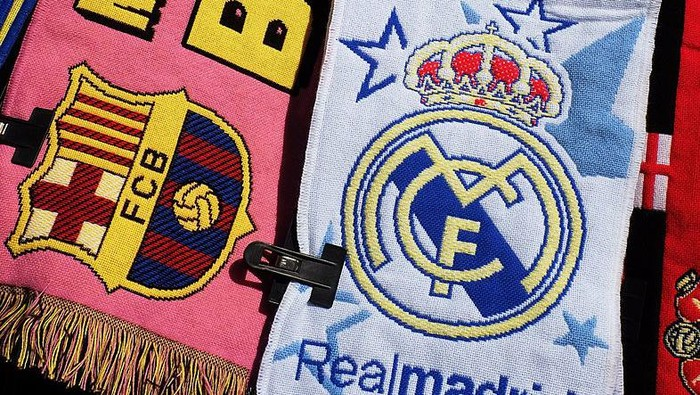 MADRID, SPAIN - DECEMBER 21:  Football scarves displaying the emblems of FC Barcelona and Real Madrid are sold on a stall on December 22, 2013 in Madrid, Spain. The European Union has opened a probe into whether Real Madrid, FC Barcelona and 5 other Spanish clubs have recieved unfair preferential treatment in the past from the government and public administrations.  (Photo by Denis Doyle/Getty Images)