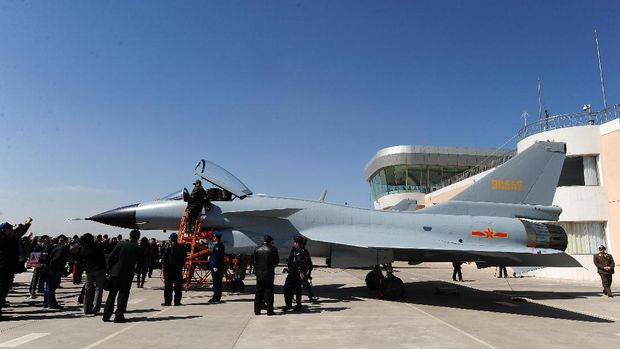 A Chinese J-10 fighter jet stands on display after an air show at the Yangcun Air Force base of the People's Liberation Army Air Force in Tianjin, home of the 24th Fighter Division, southeast of Beijing on April 13, 2010.  The base is home to the August 1st (Bayi) Aerobatic Team of the PLAAF, named after the founding of the PLA on August 1, 1927. The Aerobatics team upgraded their jets to the J-10 multirole fighter in May 2009 and military attaches from various countries as well as foreign journalists were invited to the base for the airshow. AFP PHOTO / FREDERIC J. BROWN