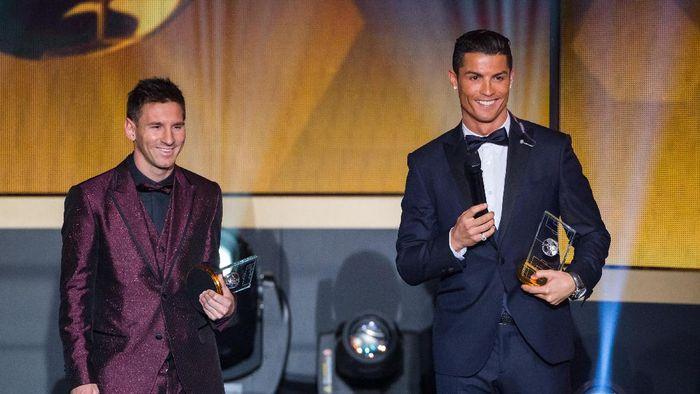Cristiano Ronaldo dan Lionel Messi sama-sama sudah lima kali menjadi pemain terbaik dunia (Foto: Philipp Schmidli/Getty Images)