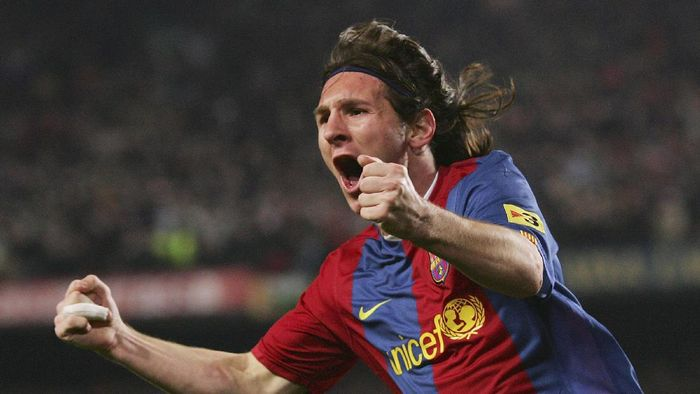 BARCELONA, SPAIN - MARCH 10:  Lionel Messi of  Barcelona celebrates after scoring their second goal during the Primera Liga match between Barcelona and Real Madrid at the Nou Camp stadium on March 10, 2007 in Barcelona, Spain.  (Photo by Denis Doyle/Getty Images)