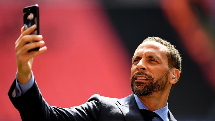 LONDON, ENGLAND - APRIL 23:  BT Sport pundit Rio Ferdinand takes a photograph prior to the Emirates FA Cup Semi-Final match between Arsenal and Manchester City at Wembley Stadium on April 23, 2017 in London, England.  (Photo by Shaun Botterill/Getty Images,)