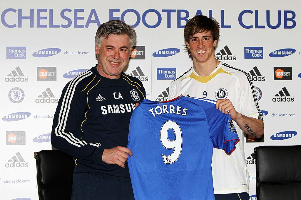 COBHAM, ENGLAND - FEBRUARY 04:  Manager Carlo Ancelotti (L) and Fernando Torres pose for the media at the Chelsea Press Conference on February 4, 2011 in Cobham, England.  (Photo by Dean Mouhtaropoulos/Getty Images)
