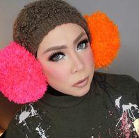 Foto: Gaya Hijab Nyentrik Melly Goeslaw Pakai Pom-pom & Headpiece