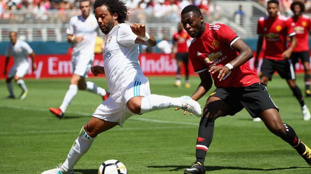 SANTA CLARA, CA - JULY 23: Marcelo Da Silva Junior #12 of Real Madrid and Timothy Fosu-Mensah #24 of Manchester United go for the ball during the International Champions Cup match at Levi's Stadium on July 23, 2017 in Santa Clara, California.   Ezra Shaw/Getty Images/AFP