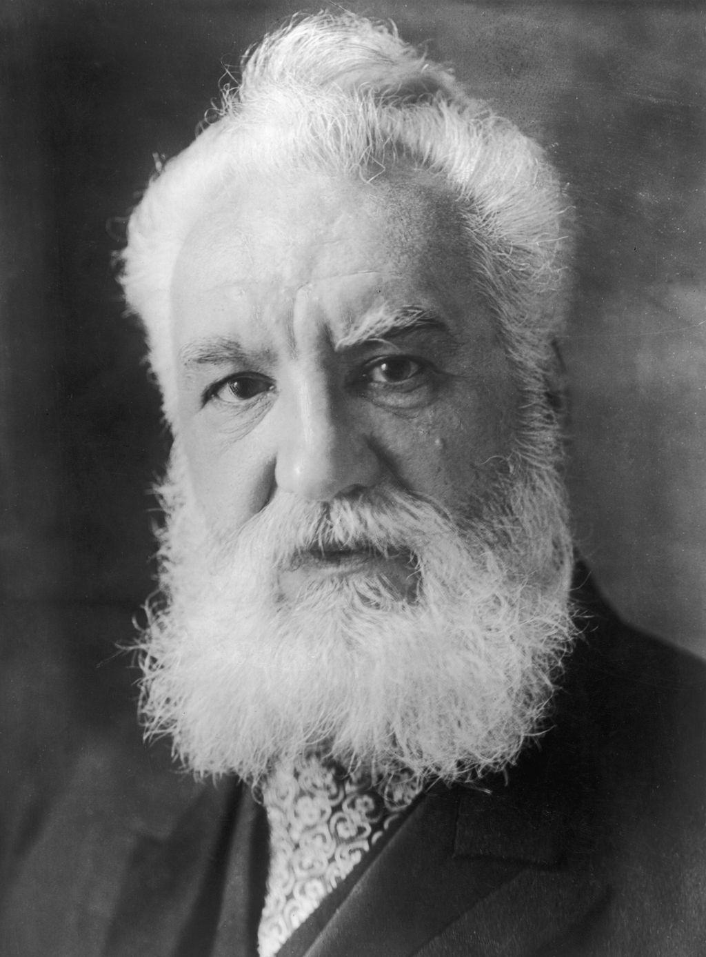 circa 1910:  Alexander Graham Bell (1847 - 1922) a Scots-born American inventor who established  the Bell Telephone Company. Bell, born in Edinburgh, worked with his father, Scottish educator Alexander Melville Bell, before emigrating to North America in 1871. In 1873 he became Professor of Vocal Phisiology at Boston University. He experimented with various devices for transmitting sound until he sent the first acoustic message to his assistant in 1875. Bell patented the telephone the next year and went on to invent the photophone and gramophone. He also founded the journal  'Science' and invented the tetrahedral kite.  (Photo by Topical Press Agency/Getty Images)