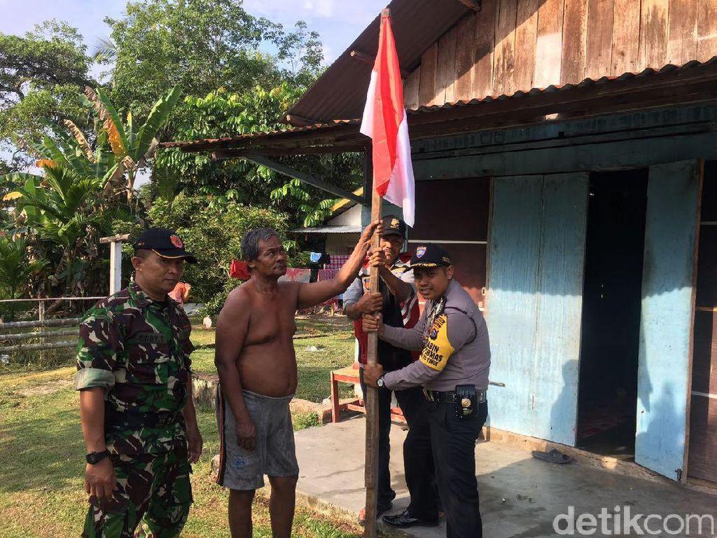 TNI-Polri Ajak Warga Pekanbaru Kibarkan Bendera Merah Putih