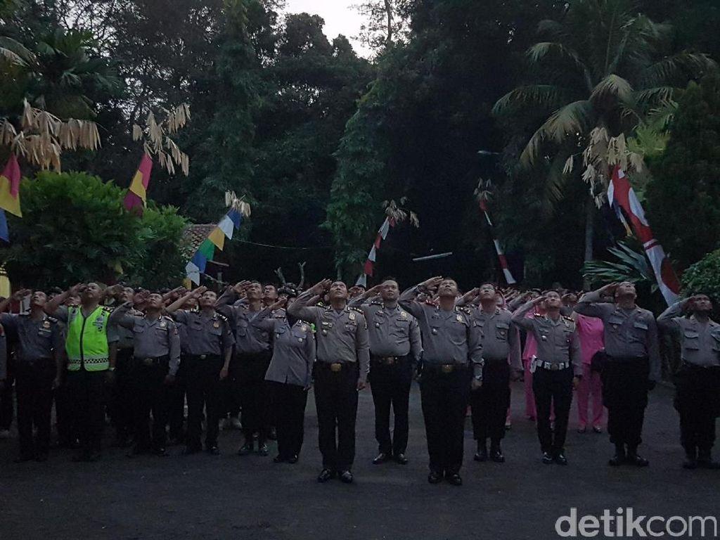 HUT RI ke-72, Kapolres Serang Kibarkan Bendera di Gunung Pinang