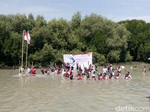Basah-basahan, Puluhan Anak Yatim Upacara di Hutan Mangrove Demak