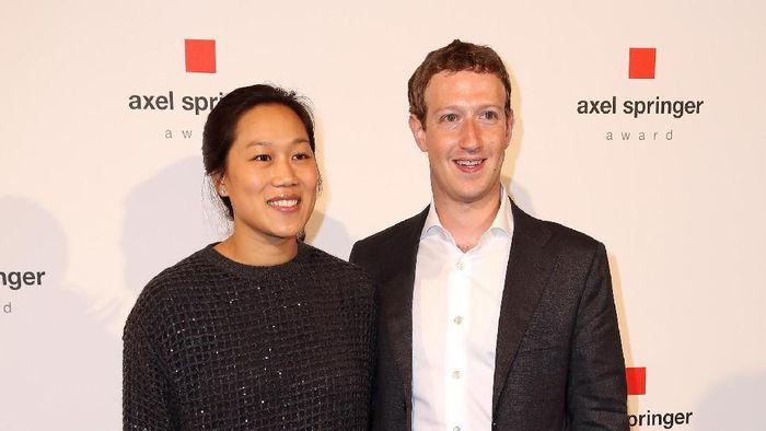 Pricilla Chan dan Mark Zuckerberg. Foto: Adam Berry/Getty Images