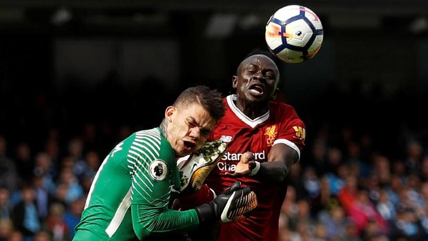 Soccer Football - Premier League - Manchester City vs Liverpool - Manchester, Britain - September 9, 2017   Manchester City's Ederson Moraes is fouled by Liverpool's Sadio Mane resulting in a red card for Mane   Action Images via Reuters/Lee Smith  EDITORIAL USE ONLY. No use with unauthorized audio, video, data, fixture lists, club/league logos or