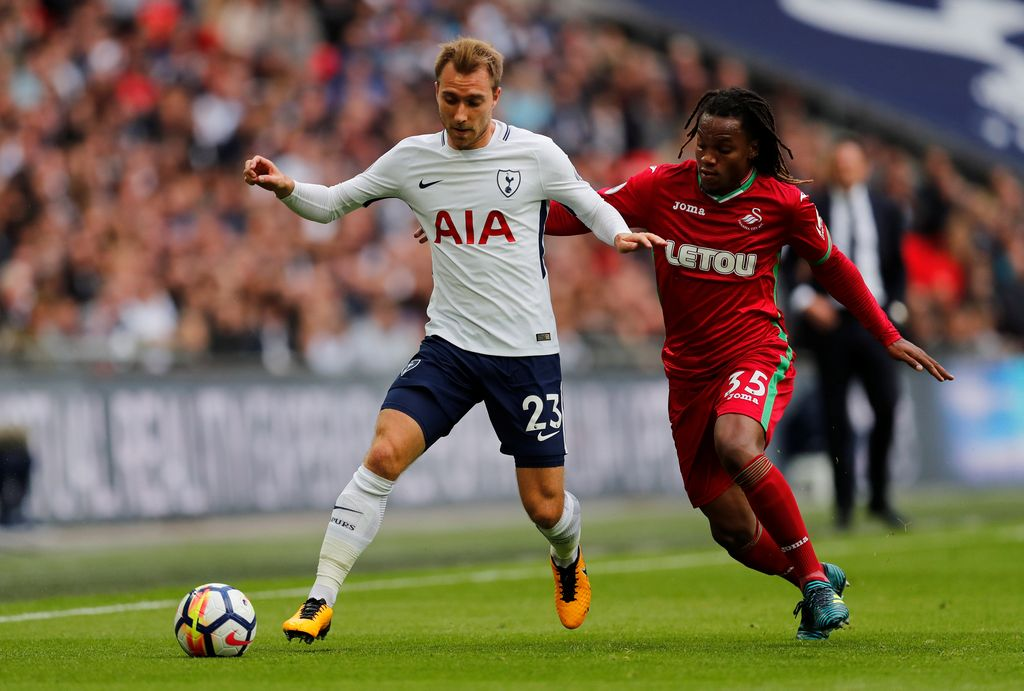 Soccer Football - Premier League - Tottenham Hotspur vs Swansea City - Wembley Stadium, London, Britain - September 16, 2017   Tottenham's Christian Eriksen in action with Swansea City's Renato Sanches        REUTERS/Eddie Keogh    EDITORIAL USE ONLY. No use with unauthorized audio, video, data, fixture lists, club/league logos or