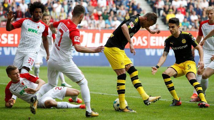 Borussia Dortmund mengalahkan Augsburg 2-1. Foto: Michaela Rehle/Reuters