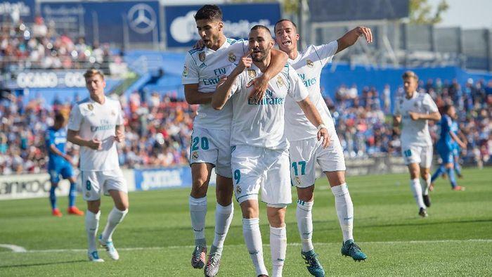 Real Madrid membuat rekor kemenangan tandang beruntun di La Liga usai mengalahkan Getafe (Foto: Denis Doyle/Getty Images)