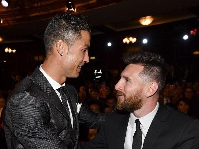 Cristiano Ronaldo dan Lionel Messi menciptakan rivalitas yang tak pernah ada sebelumnya di La Liga (AFP PHOTO / Ben STANSALL)