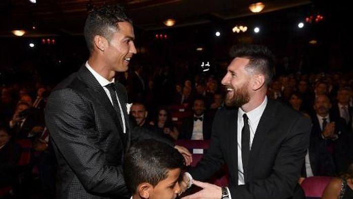 Cristiano Ronaldo dan Lionel Messi. (Foto: Ben STANSALL/AFP)