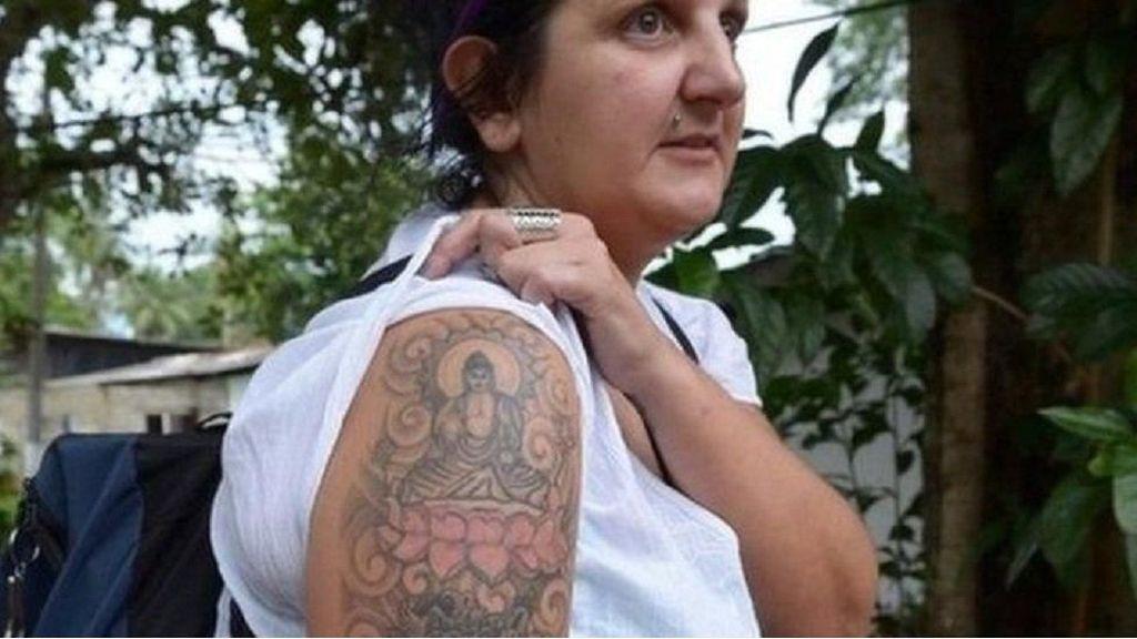 Ditahan karena Bertato Buddha, Wanita ini Dapat Ganti Rugi Rp 70 Juta