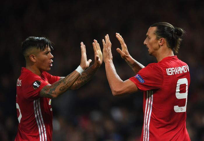 MANCHESTER, ENGLAND - SEPTEMBER 29:  Zlatan Ibrahimovic of Manchester United is congratulated by teammate Marcos Rojo after scoring the opening goal during the UEFA Europa League group A match between Manchester United FC and FC Zorya Luhansk at Old Trafford on September 29, 2016 in Manchester, England.  (Photo by Laurence Griffiths/Getty Images)