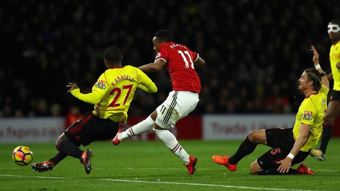 WATFORD, ENGLAND - NOVEMBER 28:  Anthony Martial of Manchester United scores the 3rd goal past Christian Kabasele of Watford during the Premier League match between Watford and Manchester United at Vicarage Road on November 28, 2017 in Watford, England.  (Photo by Richard Heathcote/Getty Images)