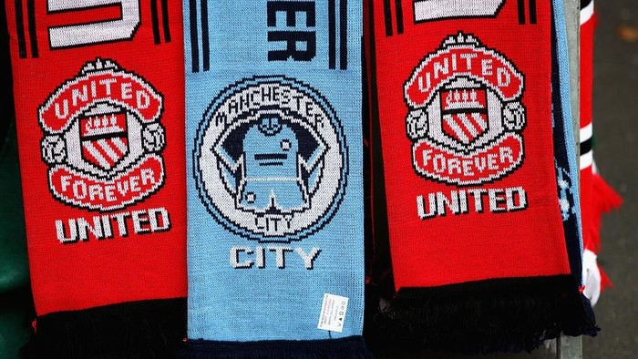 MANCHESTER, ENGLAND - SEPTEMBER 10:  Souvenirs for sale prior the Premier League match between Manchester United and Manchester City at Old Trafford on September 10, 2016 in Manchester, England.  (Photo by Clive Brunskill/Getty Images)