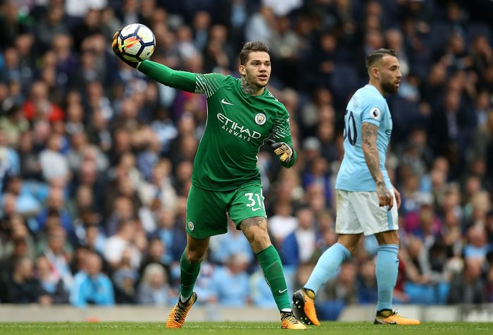 MANCHESTER, ENGLAND - OCTOBER 17: John Stones of Manchester City congratulats Ederson of Manchester City after saving a penalty during the UEFA Champions League group F match between Manchester City and SSC Napoli at Etihad Stadium on October 17, 2017 in Manchester, United Kingdom.  (Photo by Gareth Copley/Getty Images)
