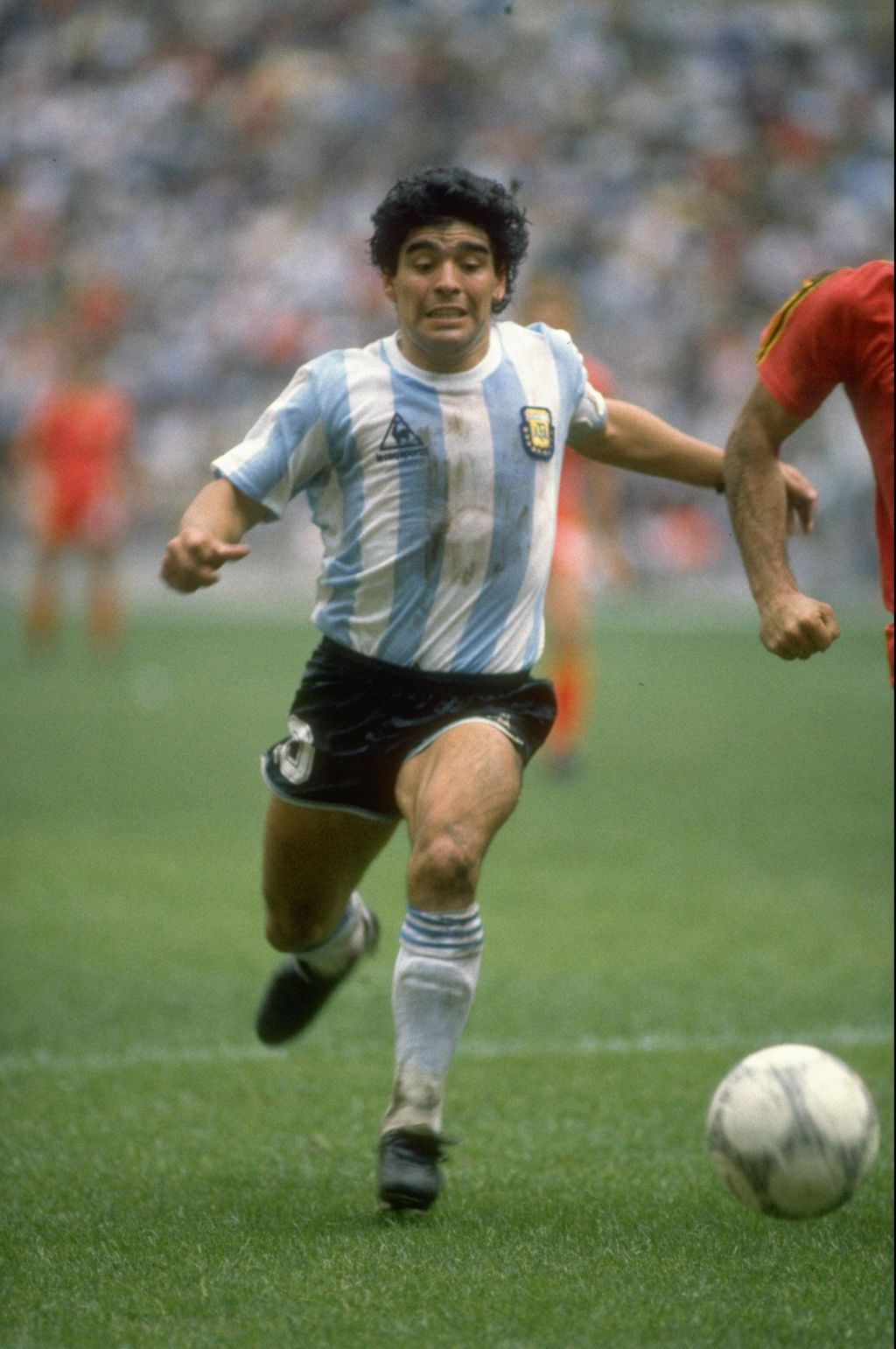 25 Jun 1986:  Diego Maradona of Argentina in action during the World Cup semi-final against Belgium at the Azteca Stadium in Mexico City. Argentina won the match 2-0.   Mandatory Credit: Mike King/Allsport