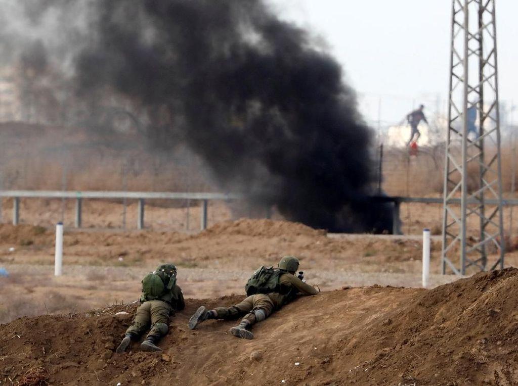 Keji! Tentara Israel Angkut Jenazah Warga Gaza dengan Buldozer