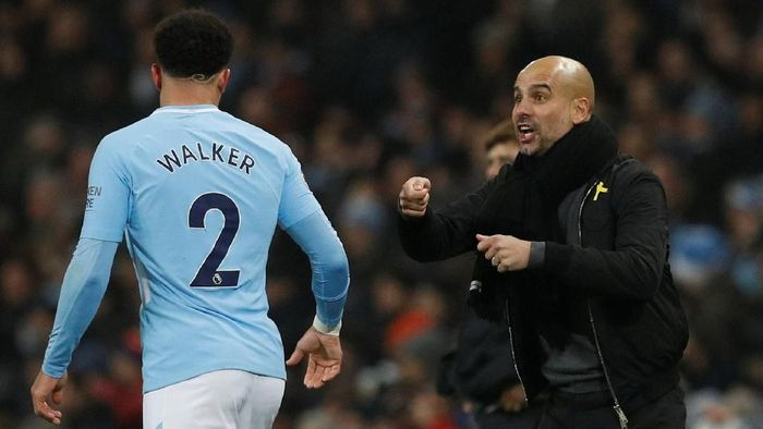 Kyle Walker dan Pep Guardiola di salah satu laga Manchester City. (Foto: Phil Noble/Reuters)
